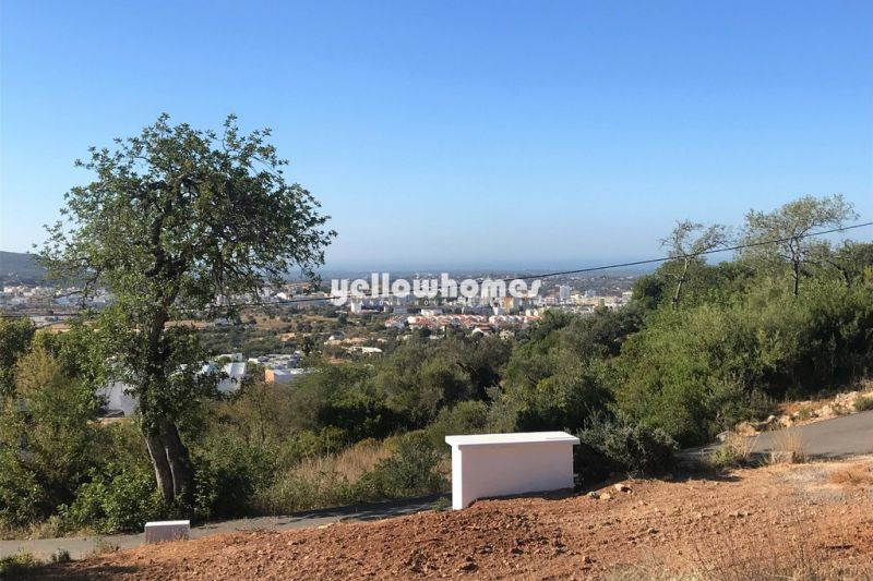 Plot with old house and great country-/sea views  near Loule